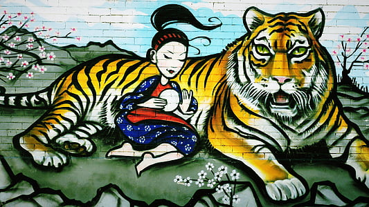 woman leaning on tiger painting