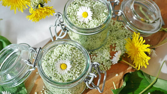 two glass jars filled with seeds