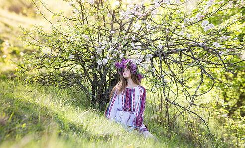 girl standing near white cherry blossom tree