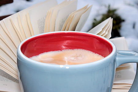 selective focus photography of white ceramic cup filled of coffee