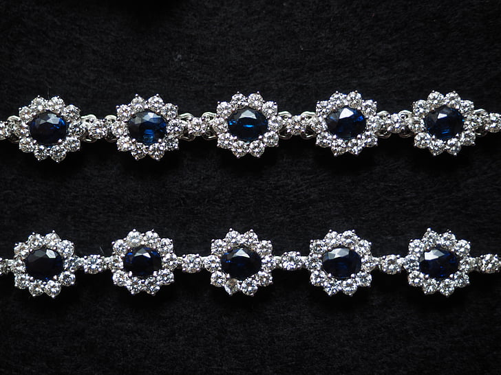 silver-colored accessories with black gemstones