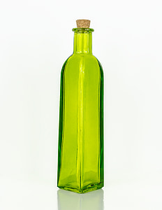 translucent green glass bottle