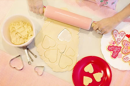 pink rolling pin near red plate