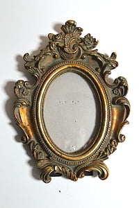 gold photo frame on white surface