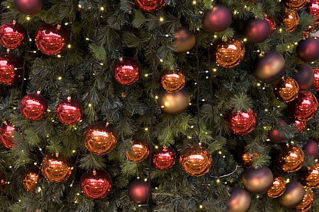 green Christmas tree with hanging red and brown baubles