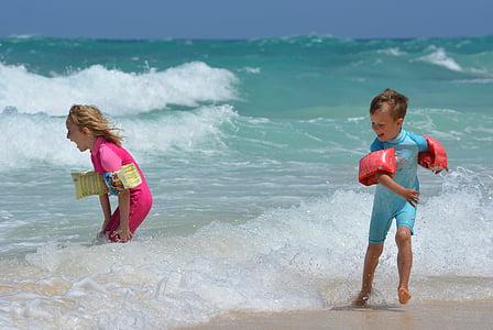 girl and boy on seashore