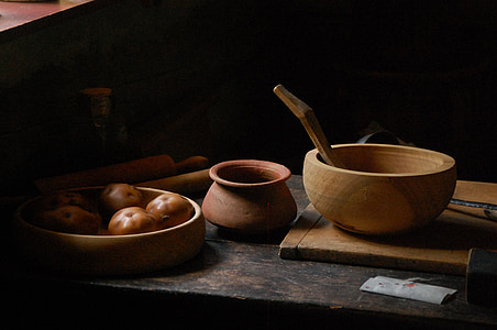 round brown bowl beside brown clay pot