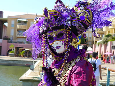 person wearing masquerade at park