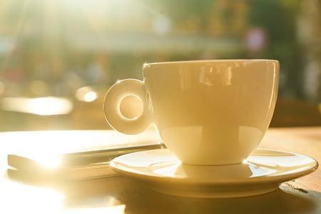 white ceramic tea cup on saucer