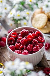 red raspberry on white ceramic ramikin bowl