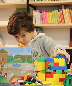 boy playing blocks toy
