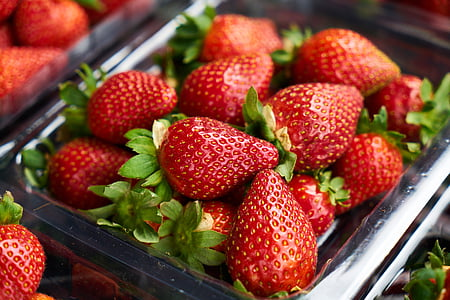 strawberries on gray tray