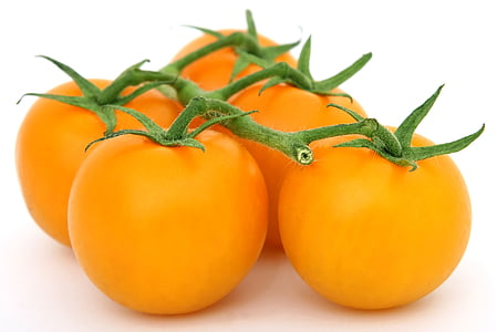five orange cherry tomatoes