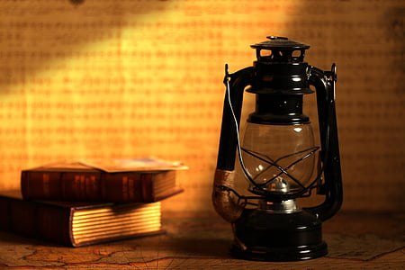 kerosene lantern beside books