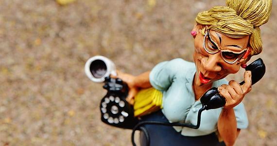 woman holding telephone figurine