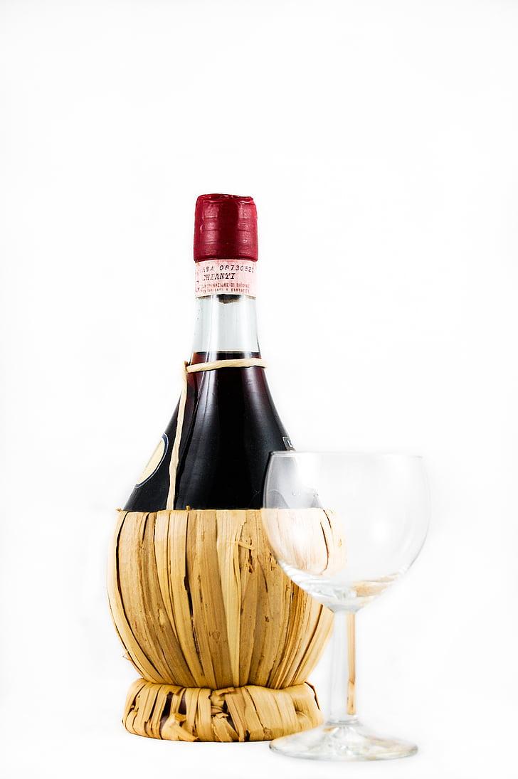 empty wine glass near wine bottle