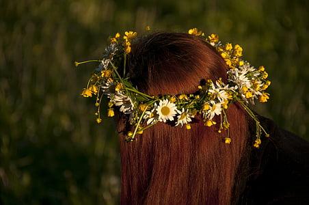 woman wearing yellow ox-eyed daisy headress