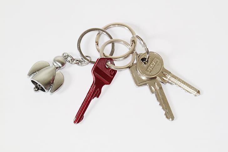 three gray and red keys