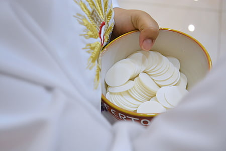selective focus of holy host in bowl