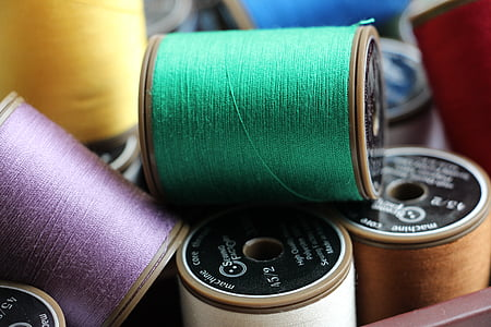 pile of assorted-color thread spools