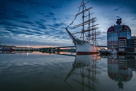 white shipe on water near port