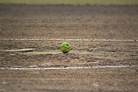 green baseball in the middle of ground