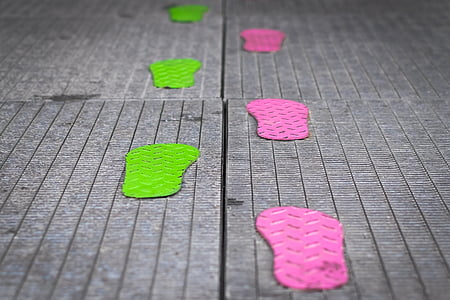 selective focus photography of green and pink footprints