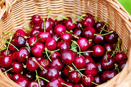 brown wicker basket with cherry fruits