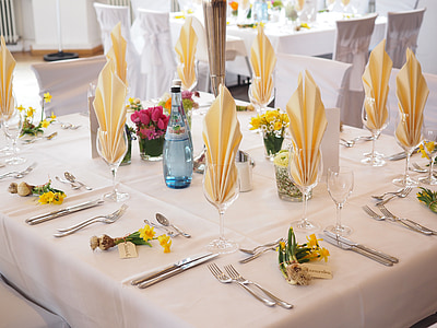 stainless steel fork on white tablecloth