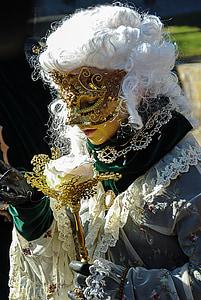 person in brown masquerade mask