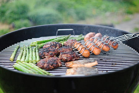 close-up photo of grilled meats and sausages on gas grill