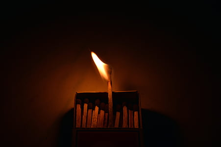 lighted match stick on match box
