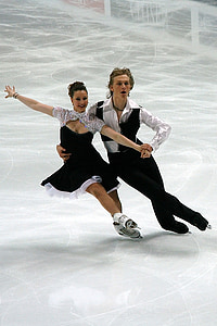 man and woman performing ice skating dance