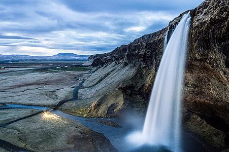 photo of waterfall at daytime