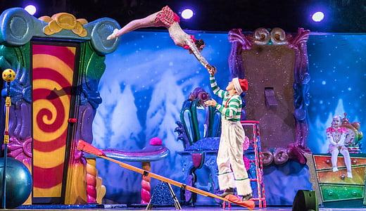man and woman doing a circus tricks
