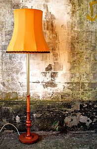 brown and orange shade table lamp on floor