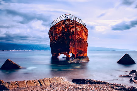 brown ruined vessel on bodies of water landscape photography