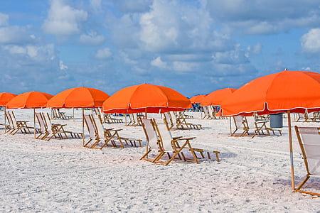 sun loungers with orange umbrellas