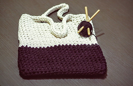 white and black knit bag
