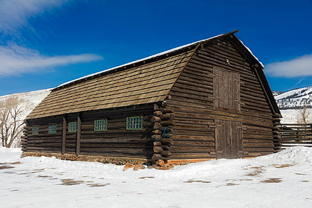 brown shack surrounded by snowfield