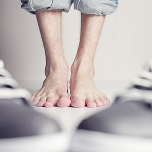 selective focus photography of human feet