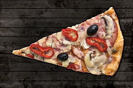 slice of pizza on gray wooden surface