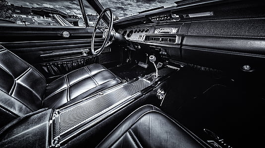 grayscale photography of classic vehicle interior