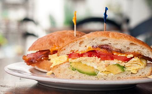 two avocado, egg, and tomato sandwiches