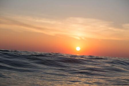 ocean waves under sunset