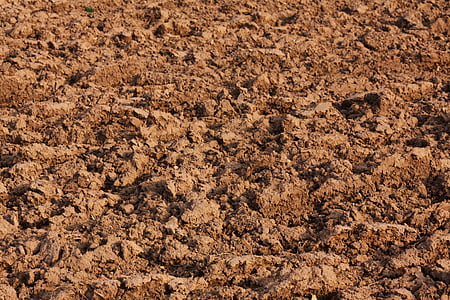 photo of brown soil at daytime