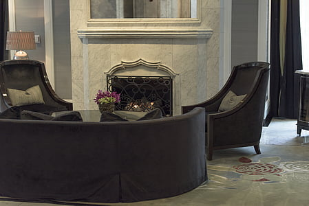 black suede couch with two armchairs