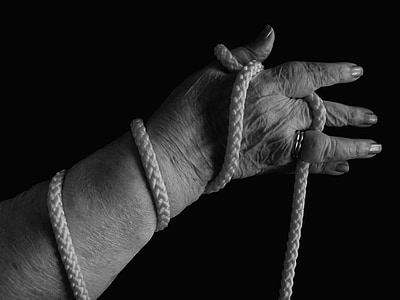 grayscale photo of woman holding rope