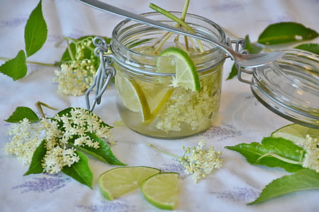 photograph of lemon juice on clear glass canister