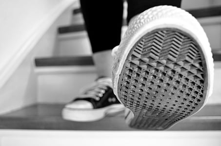 grayscale selective focus photography of shoe sole